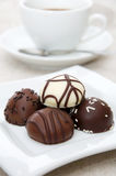 Some different  chocolate candies. On white plate Royalty Free Stock Images