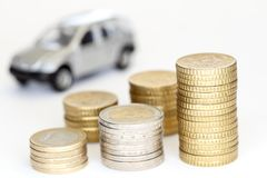 Some different euro coin stacks with car. In background Stock Photos