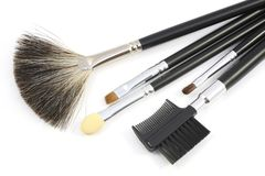 Some different kind of make-up brushes. On white Stock Images