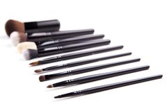 Some different kind of make-up brushes  on white.  Stock Photos