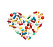 Some different pills in a heart form. On white Stock Image