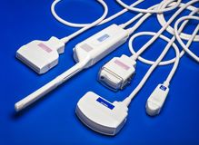 Some ultrasound probes. Some different ultrasound probes on blue background Royalty Free Stock Photography
