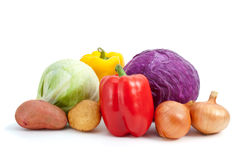 Some different vegetables. Some vegetables (potato, bell peppers, onions, cabbage) isolated on the white background Royalty Free Stock Photos