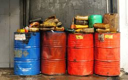 Dirty & oily plastic canisters on waste oil barrels tank royalty free stock photos