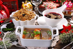 Some dishes for traditional polish christmas eve supper. Carp in jelly,sauerkraut with mushrooms,red borscht and dried fruit cake for traditional polish Royalty Free Stock Images