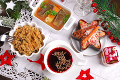 Some dishes for traditional polish christmas eve supper. Red borscht,sauerkraut with mushrooms,carp in jelly, and dried fruit cake for traditional polish Stock Photography