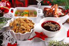 Some dishes for traditional polish christmas eve supper. Sauerkraut with mushrooms,carp in jelly,red borscht and dried fruit cake for traditional polish Royalty Free Stock Photos
