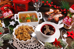 Some dishes for traditional polish christmas eve supper. Sauerkraut with mushrooms,carp in jelly,red borscht and dried fruit cake for traditional polish Stock Image