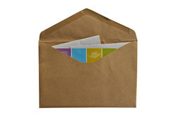 Some documents in brown paper envelope. Some documents in opened brown paper envelope on white background royalty free stock photography