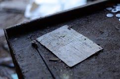 Some documents in Izumrudnoe camp near Chernobyl. Some papers on the table in Izumrudnoe camp Stock Images