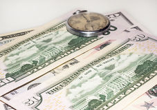Some dollars and old watch. American dollar bank bills and old watch Royalty Free Stock Photos