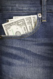 Some dollars in a pocket of denim jeans. With space royalty free stock images