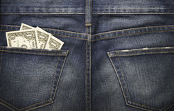 Some dollars in a pocket of denim jeans. With space Stock Photos