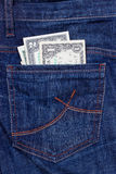 Dollars in a pocket of jeans. Some dollars in a pocket of jeans Royalty Free Stock Images