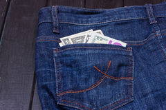 Dollars in a pocket of jeans. Some dollars in a pocket of jeans Royalty Free Stock Image
