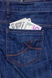 Dollars in a pocket of jeans. Some dollars in a pocket of jeans stock image