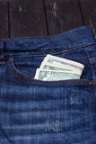 Dollars in a pocket of jeans. Some dollars in a pocket of jeans Stock Photos