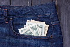 Dollars in a pocket of jeans. Some dollars in a pocket of jeans Royalty Free Stock Photos