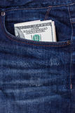 Dollars in a pocket of jeans. Some dollars in a pocket of jeans Stock Photography
