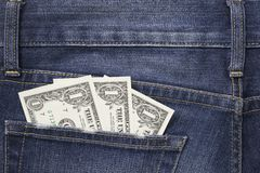 Some dollars in a pocket of jeans. With space stock photography