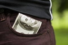 Some dollars in the pocket. One hundred dollars in the pocket Royalty Free Stock Photo