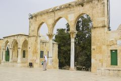 A pilgrim entering the Temple Mount through the arched gate and stock photography
