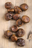 Some dried figs on wood. Some organic dried figs on brown wood Stock Photo