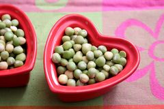 Dried green peas. Some dried green peas in a bowl royalty free stock photos