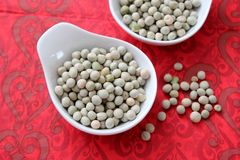 Dried green peas. Some dried green peas in a white bowl stock image