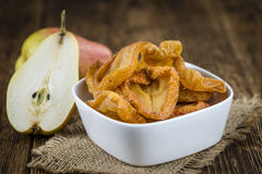 Some dried Pears (selective focus). Some dried Pears (selective focus, close-up shot) on wooden background stock photography