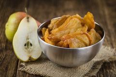 Some dried Pears (selective focus). Some dried Pears (selective focus, close-up shot) on wooden background Stock Photo