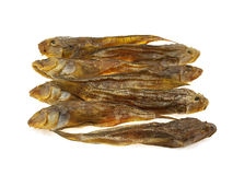 Some dried sea fishes. Isolated on a white background Royalty Free Stock Images