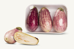 Some eggplants over a white background. Fresh vegetable Royalty Free Stock Photos