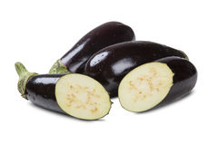 Some eggplants over a white background. Fresh vegetable Royalty Free Stock Images