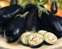 Some eggplants over a wooden surface. Fresh vegetable Stock Photos