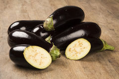 Some eggplants over a wooden surface. Fresh vegetable Royalty Free Stock Images