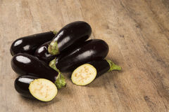 Some eggplants over a wooden surface. Fresh vegetable Stock Photo