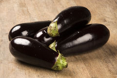 Some eggplants over a wooden surface. Fresh vegetable Stock Photography