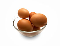 Some eggs in glass plate. On white background royalty free stock photography