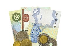Some egyptian pound bank notes and coins. With copyspace stock photography