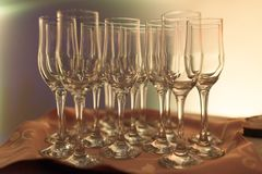 Some empty glasses on a front of reception. Some champagne ready to be filled with champagne at reception Royalty Free Stock Photography