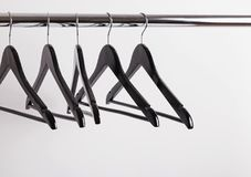 Some empty hangers on the rack. Sale concept royalty free stock photo