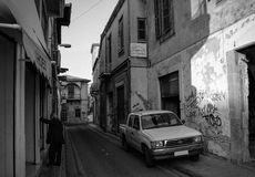 Some empty old street in Nicosia. Some empty old street with car and man in Nicosia Royalty Free Stock Image