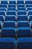 Some empty seats. Some rows of empty seats in blue, seen from above royalty free stock photography