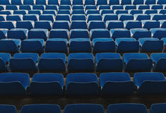 Some empty seats. Some rows of empty seats in blue, seen from above royalty free stock photos
