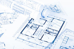 Some engineering drawings. Engineering drawings on a table and other wound royalty free stock photography