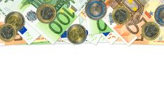 Some 50 and 100 euro bank notes and coins. With copy space royalty free stock photos