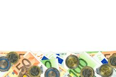 Some 50 and 100 euro bank notes and coins. With copy space Stock Photography