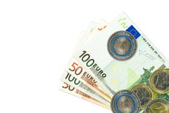 Some 50 and 100 euro bank notes and coins. With copy space stock photos