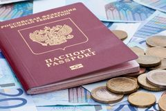 Some euro banknotes, coins and russian passport. Isolated on the table stock images